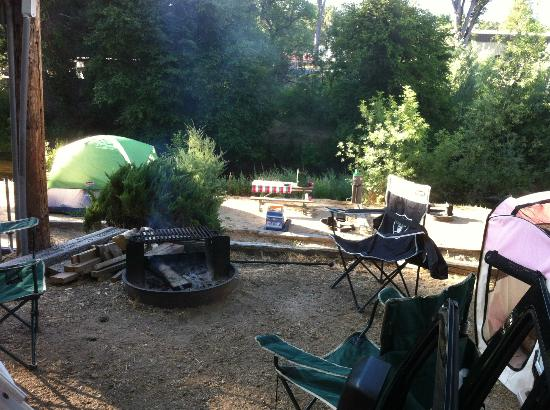High Sierra RV Park & Campground: Fire ring at site 40 overlooking tent sites and stream