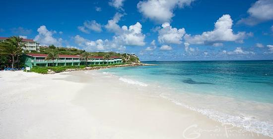 Grand Pineapple Beach Antigua: Experience the white sands, clear turquoise waters, and spontaneous island spirit.