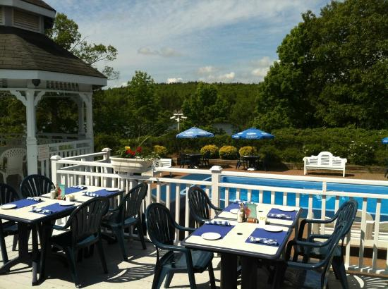 Inn on the Lake: view from the dining area outside, overlooking the pool & river