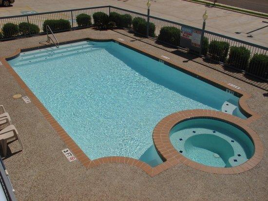 Enjoy a swim in our outdoor pool and jacuzzi picture of for Swimming pool with jacuzzi design