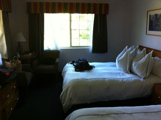 BEST WESTERN Bard&#39;s Inn: Double queen bed room.  Not shown is the sitting area (equal to the length of what you see here)