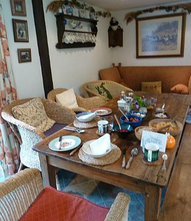 Yew Tree Cottage Bed and Breakfast: The Kitchen table setup for a yummy breakfast...
