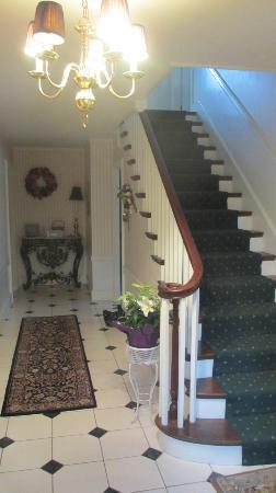 Around the Corner Bed &amp; Breakfast: The entrance way and the staircase to our room upstairs.