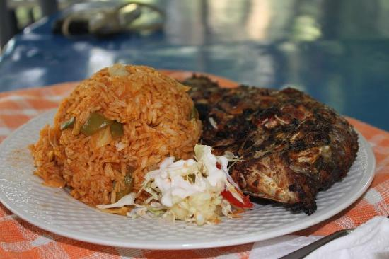 Whole Grilled Tilapia with Jollof Rice - Picture of Aylos Bay Guest ...