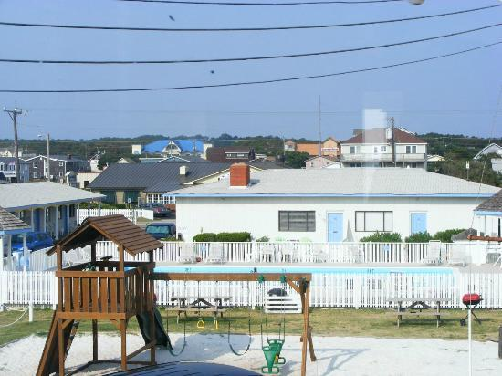Outer Banks Motor Lodge: view from our room's back window of the playground and pool