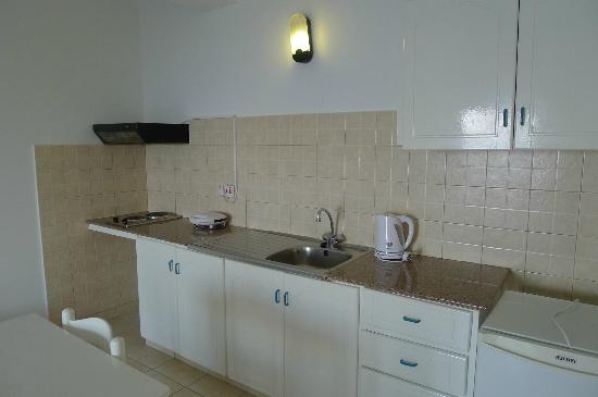 Konnos Bay Hotel Apartments: featured with mini kitchen at living hall