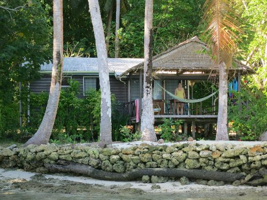 Uepi Island Resort: Beachfront bungalow seen from the lagoon, Uepi