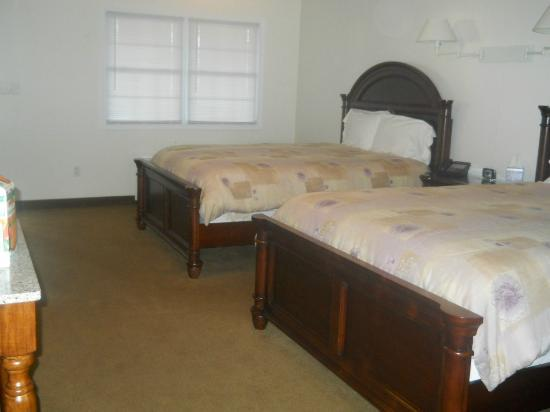 Shore Stay Suites: Beds towards door, also full size double closet with ironing board.