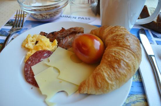 A typical Swiss breakfast. The eggs were colored to ...