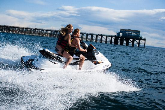 Cruise in a jet ski next to the Oceanside Pier.