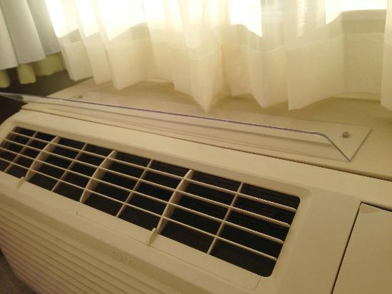 SpringHill Suites by Marriott/ Sarasota Bradenton: Plastic attached to AC unit which directed air on to the bed