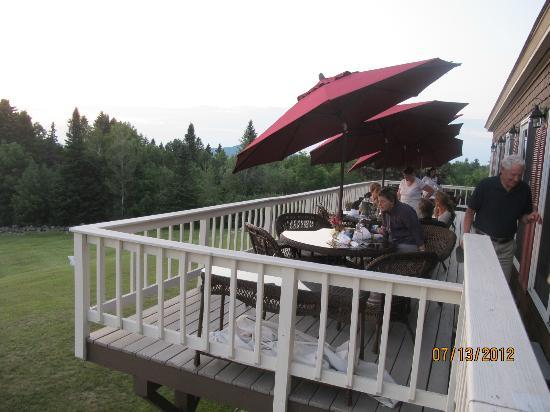 Lodge at Moosehead Lake: Outdoor dining porch on back of lodge with views of lake.