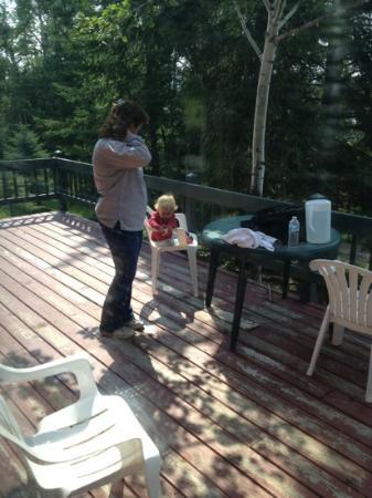 Cross River Lodge: grandma and Lena spending some time out in the deck of the Jack Pine cabin