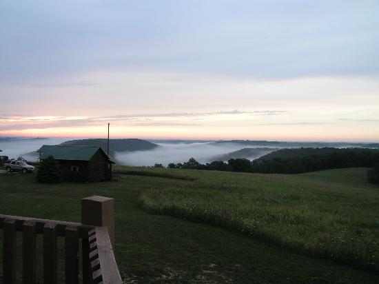 Pine Creek Cabins &amp; Campground: View from the deck of morning fog over the river valley