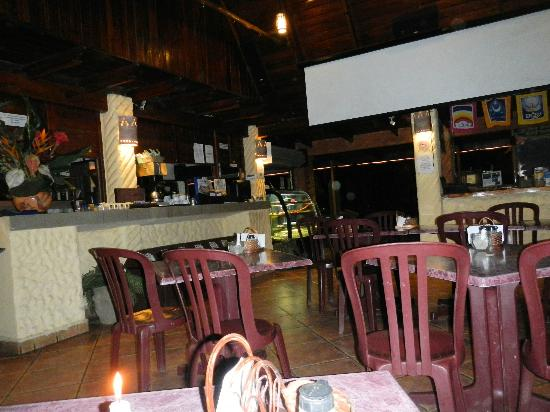 El Sano Banano Village Hotel: Dining room with movie screen