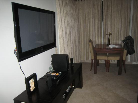 Dolphin Beach Apartments: Living room with TV and surround sound