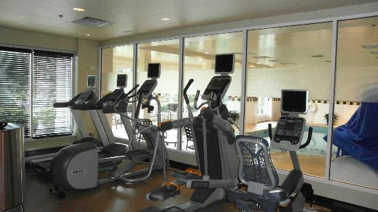 : Gym next to the pool.