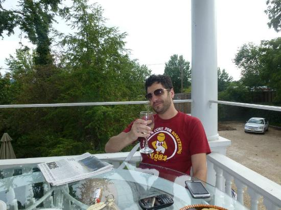 200 South Street Inn: Scotty enjoying a glass of wine on the wrap around deck