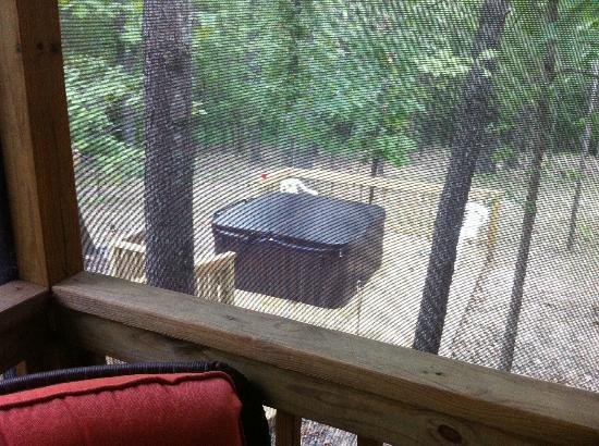 Cedar Rock Cabins: View of the Hot Tub from the Screened in Porch