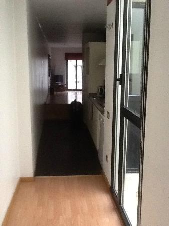 FGA Liceu Apartments: view from kitchen down to living area