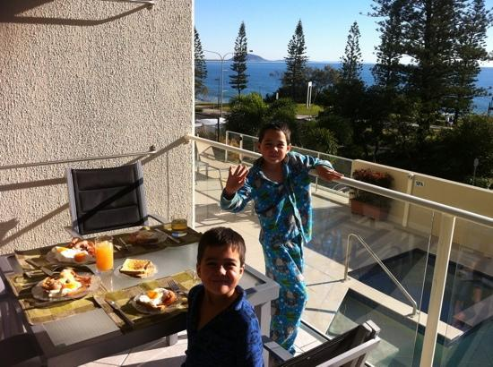 Pacific Beach Resort: our sons enjoying breakfast on the balcony.