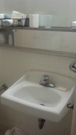 Missouri Athletic Club: No sink space. Mini shelf above only.