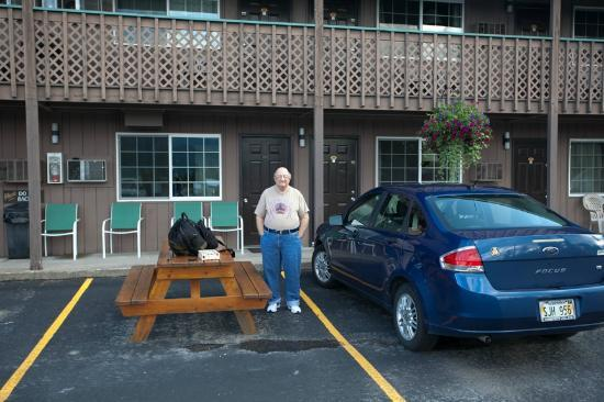 Chalet Motel: My friend and car in front of our room.