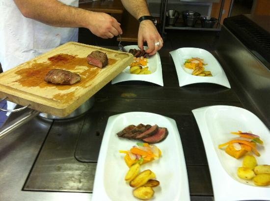 plating our main course duck breast in ginger brown