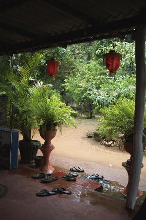 Nilmini Lodge: The garden which the veranda overlooks