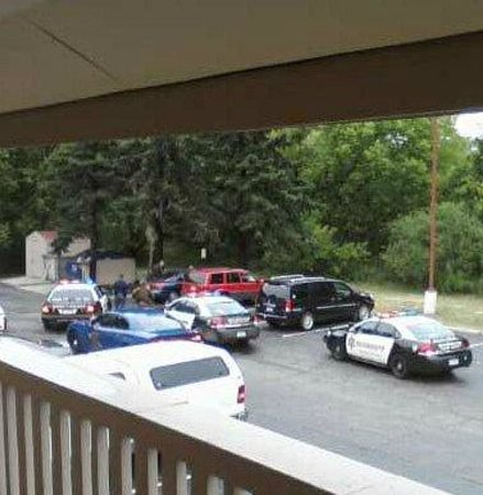 "Red Roof Inn Lansing West: Police activity (like a ""Cops"" episode live)"