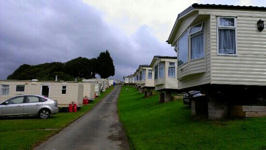 Combe Martin, UK: caravans at the sandaway beach.