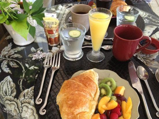 Two Bees Bed & Breakfast: Homemade croissant at a beautifully set breakfast table for two.