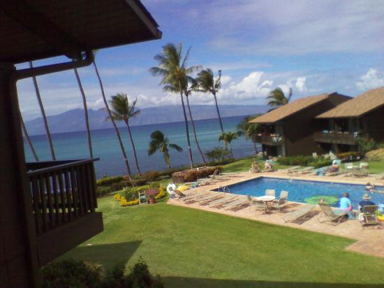 Mahina Surf: View of the pool area from the balcony of condo #222