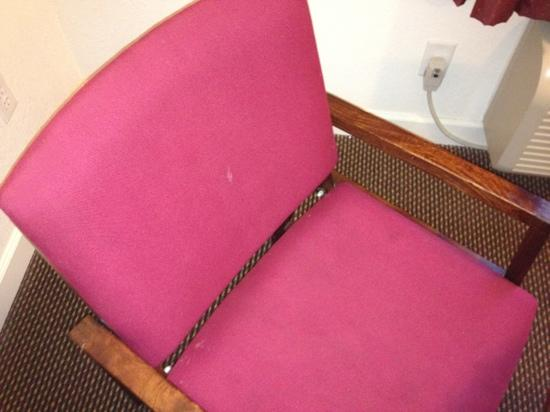 Super 8 St Louis Airport: chair w/ white stain.
