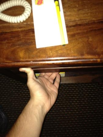Super 8 St Louis Airport: bedside table drawer I tried to open. must've been glued shut.