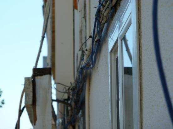 Sea Garden Motel: this is the abortion of wires outside my room! (in the back)