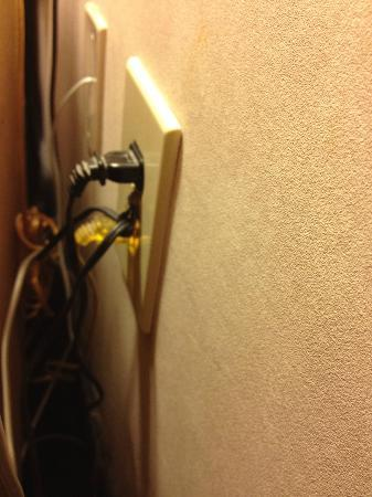 Days Inn &amp; Suites Golden / West Denver: There is a wire screwed into the center of this plug!