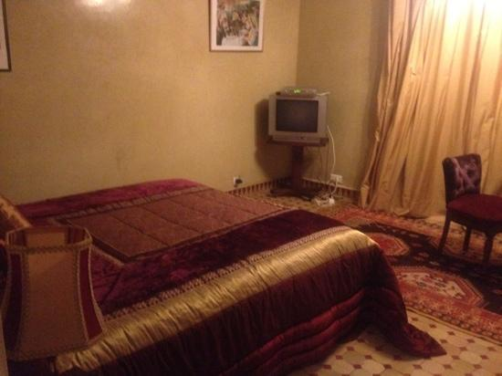 Riad Jnane Sherazade: velvet and satin bed in Jnane Sherazade with garden patio