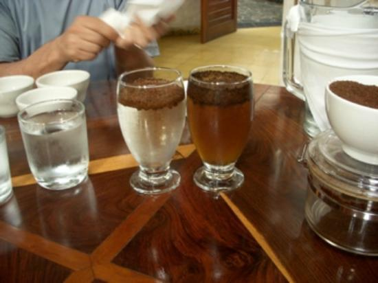 Finca Rosa Blanca Coffee Plantation & Inn: Cupping session (organic coffee on the left, store bought on the right - the brown is sugar adde