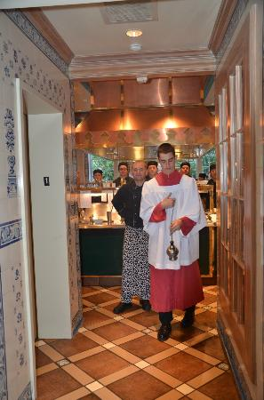 Inn at Little Washington: Entering the kitchen...we were welcomed by a young man dressed as an acolyte, swinging a censor