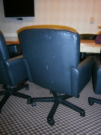 Comfort Suites: White splatter on the back of a chair