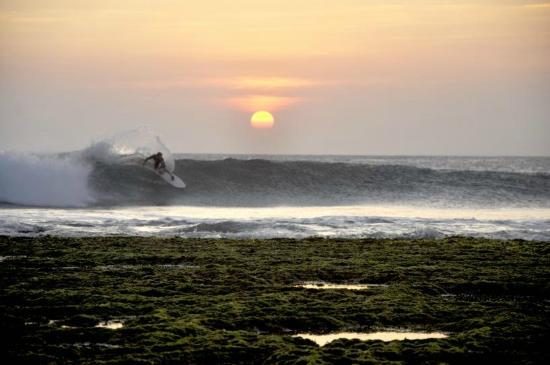 Surfing at sunset at Ombak Tujuh