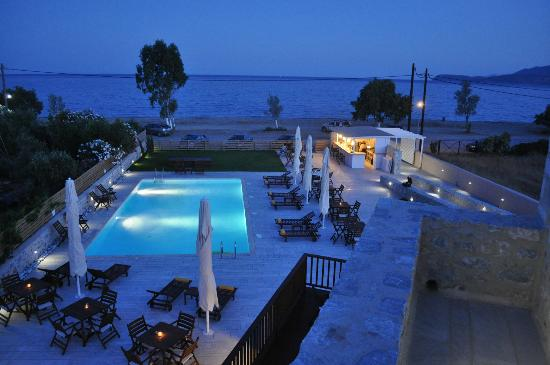 Thirides Beach Resort: The pool area by night