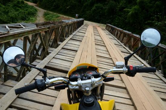 Uncle Tom's Trails - Private Day Tours: Taking one of the many bridges around Vang Vieng