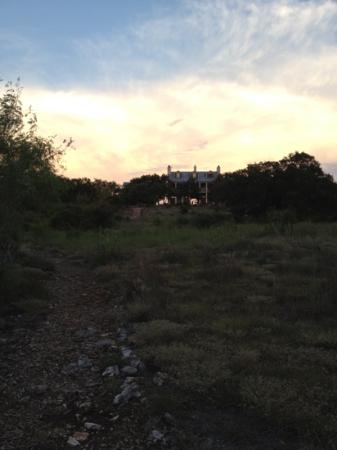 The Inn Above Onion Creek: a view of the main house from the trail