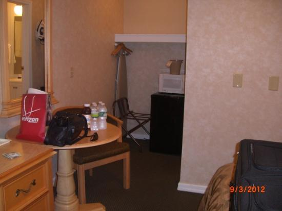 Marine Village Resort: The tiny closet, table, and chair. The bathroom is to the right of the mini fridge.