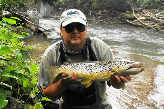 Happy fishing guest with his elkhorn creek trout for Trout fishing in wv