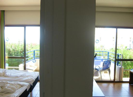 Sunwing Resort Sandy Bay: view from the hallway to bedroom on the left and livingroom at the wright