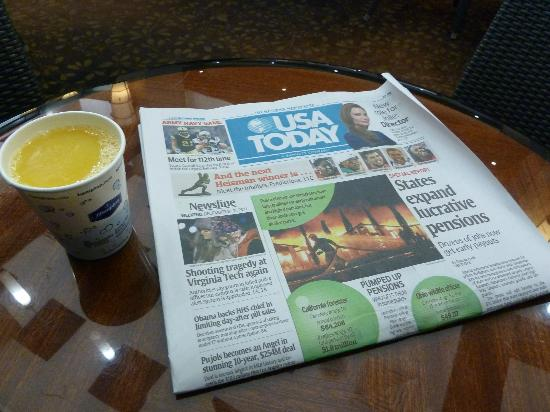 Hampton Inn Manhattan-SoHo: A complimentary paper while you have your morning coffee (or in my case ornage juice!)