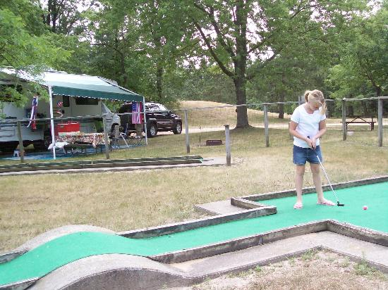 Stand Rock Campground: Grand-daughter Sarah playing minature golf with our RV in the background. Look how large this s
